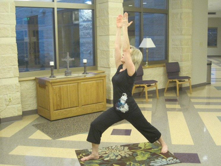 "An instructor performing ""Overcomer"" pose."