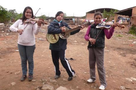 Girls playing instruments made of recycled parts © Landfill Harmonic http://www.landfillharmonicmovie.com