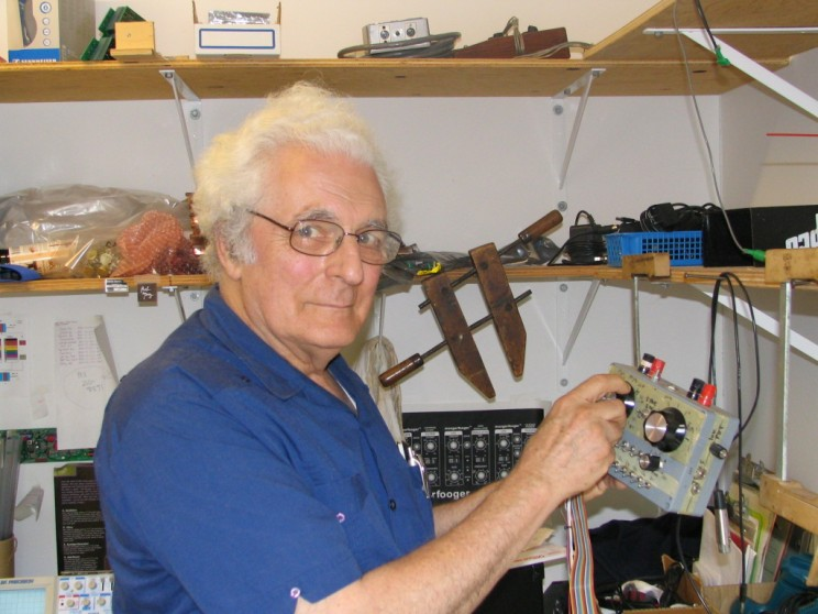 Synthesizer pioneer Bob Moog poses with an unknown device in the Moog Music office in July 2004.
