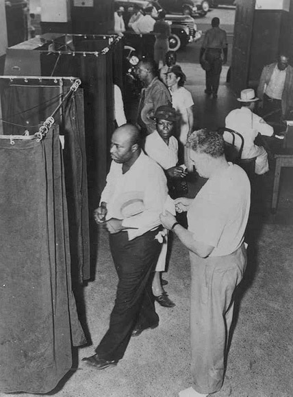 Voters at the Voting Booths. ca. 1945. NAACP Collection, The African American Odyssey: A Quest for Full Citizenship, Library of Congress. Public domain via Wikimedia Commons.