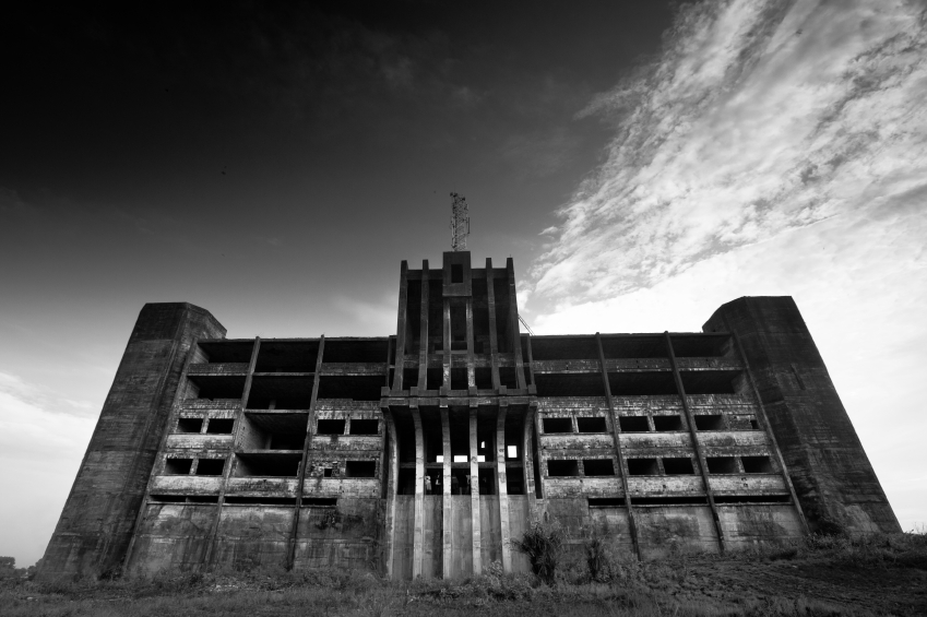 Monrovia, Liberia - 24 February 2012: The abandoned Ministry of Defence building stands empty and ruined, a reminder of the civil war here not so long ago. © MickyWiswedel via iStockphoto.