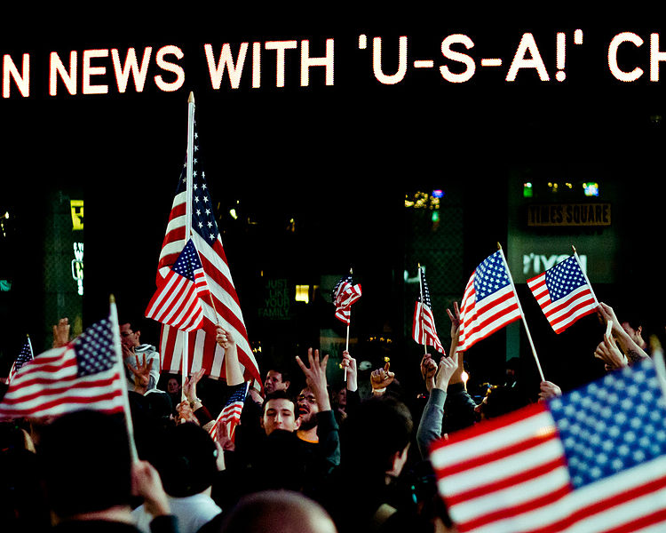 Flagwaving in Times Square on the night Osama bin Laden killed. Photo by Josh Pesavento. CC BY 2.0 via Wikimedia Commons