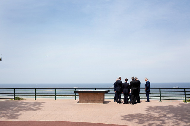President Barack Obama marks the 65th anniversary of the D-Day invasion with veterans Clyde Combs and Ben Franklin as well as French President Nicolas Sarkozy, British Prime Minister Gordon Brown, Canadian Prime Minister Stephen Harper, and Prince Charles on 6 June 2009. Official White House photo by Pete Souza via The White House Flickr.