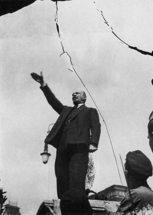 A visionary.     (Lenin  making a speech in the Red Square at the unveiling of a temporary monument to Stepaz Razin in 1919. Photo by G.P.Goldshtein. Public domain via Wikimedia Commons.