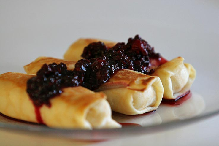 Cheese blintzes with blackberries. Photo by Susánica Tam. CC BY 2.0 via Wikimedia Commons.