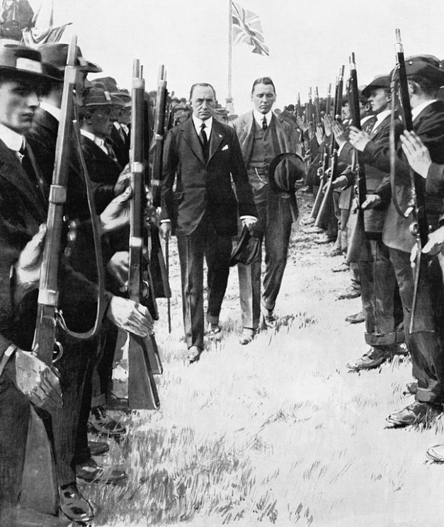 Sir Edward Carson, leader of the Irish Unionist Party, inspecting members of the Ulster Volunteer Force. The UVF were founded in 1913 by the Ulster Unionist Council to resist the implementation of Home Rule. Q 81759 Imperial War Museums. IWM Non Commercial Licence via Wikimedia Commons.