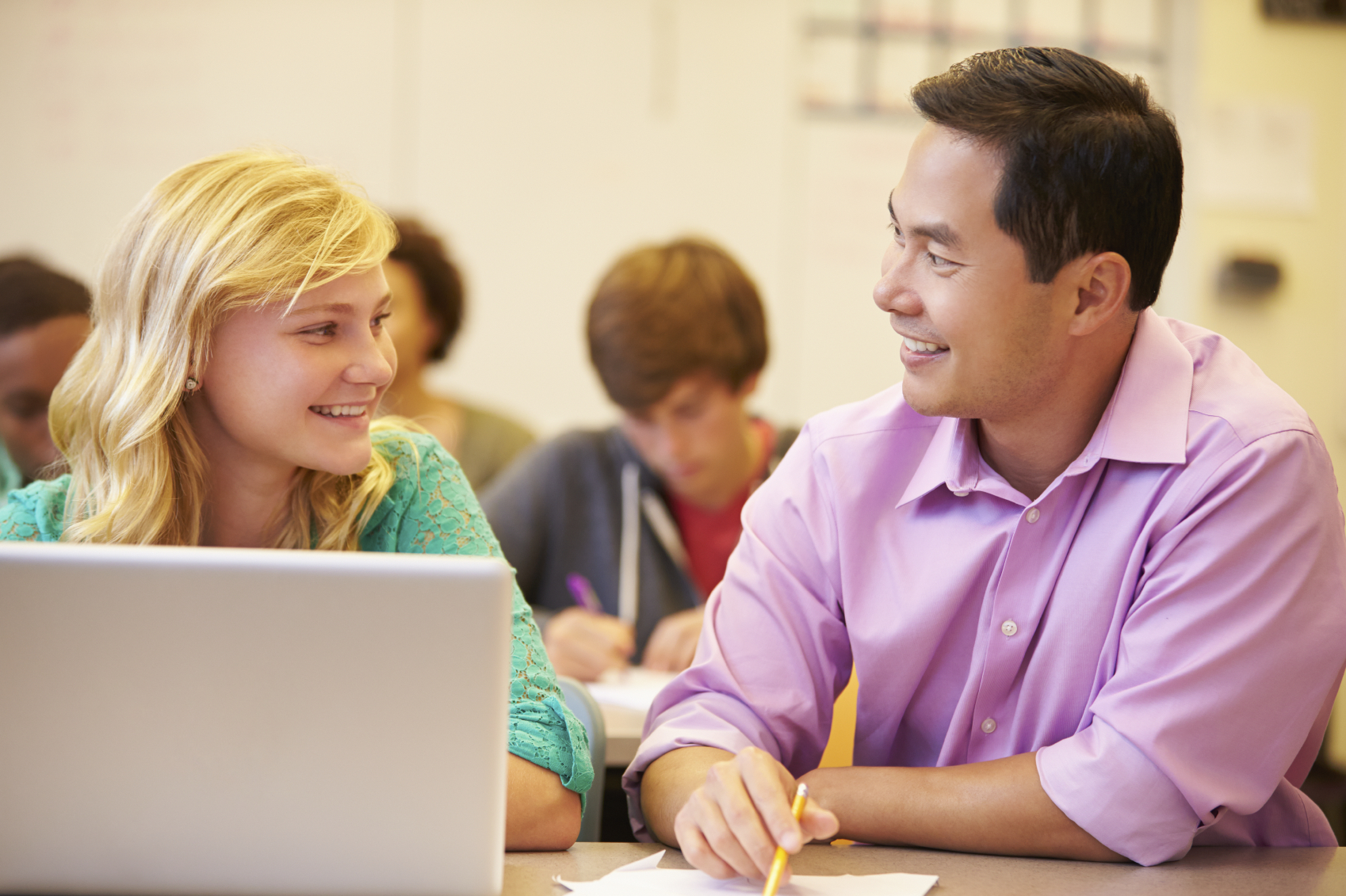 Student With Teacher In Class.  © monkeybusinessimages via iStock.