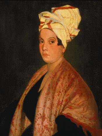 1920 painting of Marie Laveau (1794–1881) by Frank Schneider, based on an 1835 painting (now lost?) by George Catlin. Louisiana State Museum, New Orleans. Public domain via Wikimedia Commons.