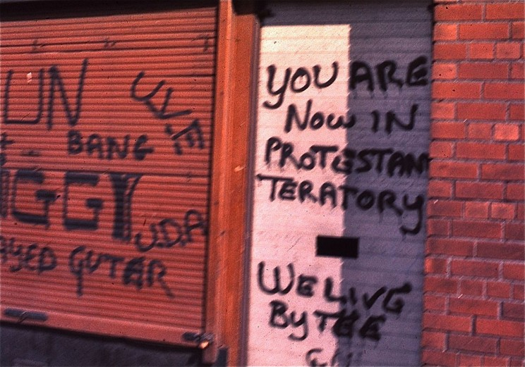 Protestant graffiti in Belfast, Northern Ireland, 1974, during The Troubles by GeorgeLouis. CC BY-SA 3.0 via Wikipedia.