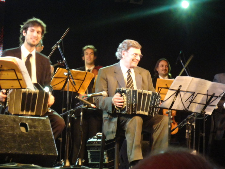 Tangueros Lautaro Greco and Leopoldo Federico (left to right) playing the bandoneón at the 2011 Tango Festival, Buenos Aires, AR, photo taken by authors.