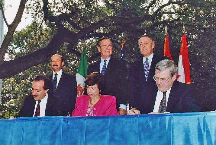 NAFTA Initialing Ceremony, October 1992 by George Bush presidential library and museum Public domain via Wikimedia Commons.