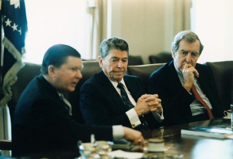 President Reagan receiving the tower commission report in the Cabinet Room, 1987 via Wikipedia.