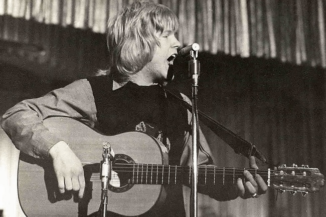"The ""Father of Christian Rock,"" Larry Norman, performing at the Hollywood Paladium ca. 1970. Courtesy of Archives, Hubbard Library, Fuller Theological Seminary."