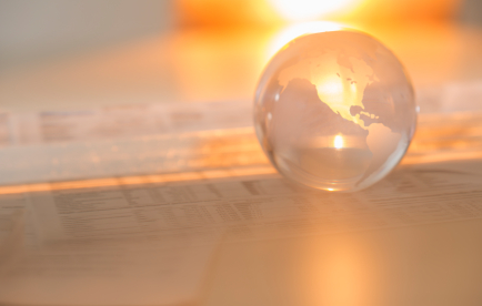 Crystal Globe On Financial Papers