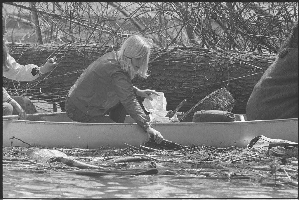 Girl Scout in canoe, picking trash out of the Potomac River during Earth Week. O'Halloran, Thomas J., photographer 1970 April 22. Courtesy of Library of Congress