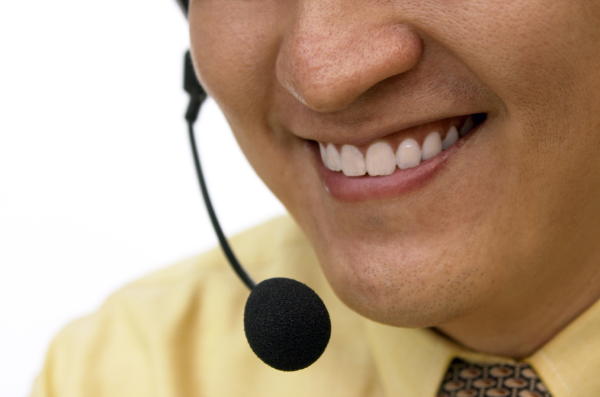 Close up of a man smiling  on the line through a headset. © cenix via iStockphoto.