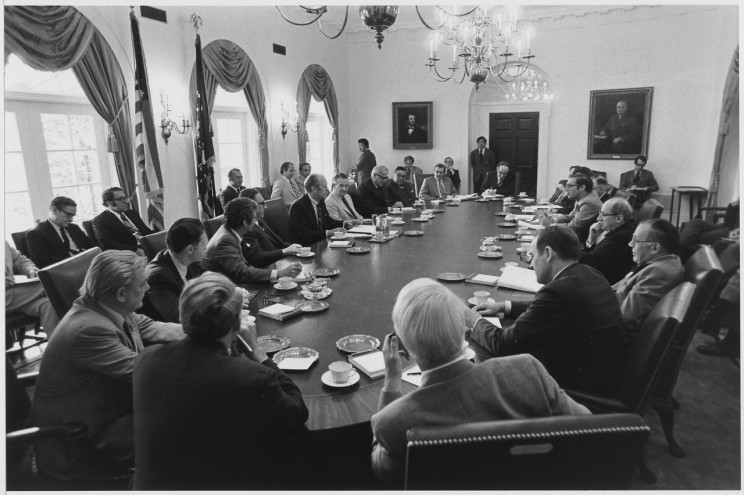 Photograph of President Gerald R. Ford Presiding Over an Afternoon Cabinet Meeting in the Cabinet Room. Bill Fitz-Patrick, Photographer. 4 June 1975. Gerald R. Ford Presidential Library, US National Archives and Records Administration. Public domain via Wikimedia Commons.