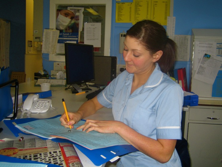 A British nurse writing her notes. Creative Commons via Flickr.