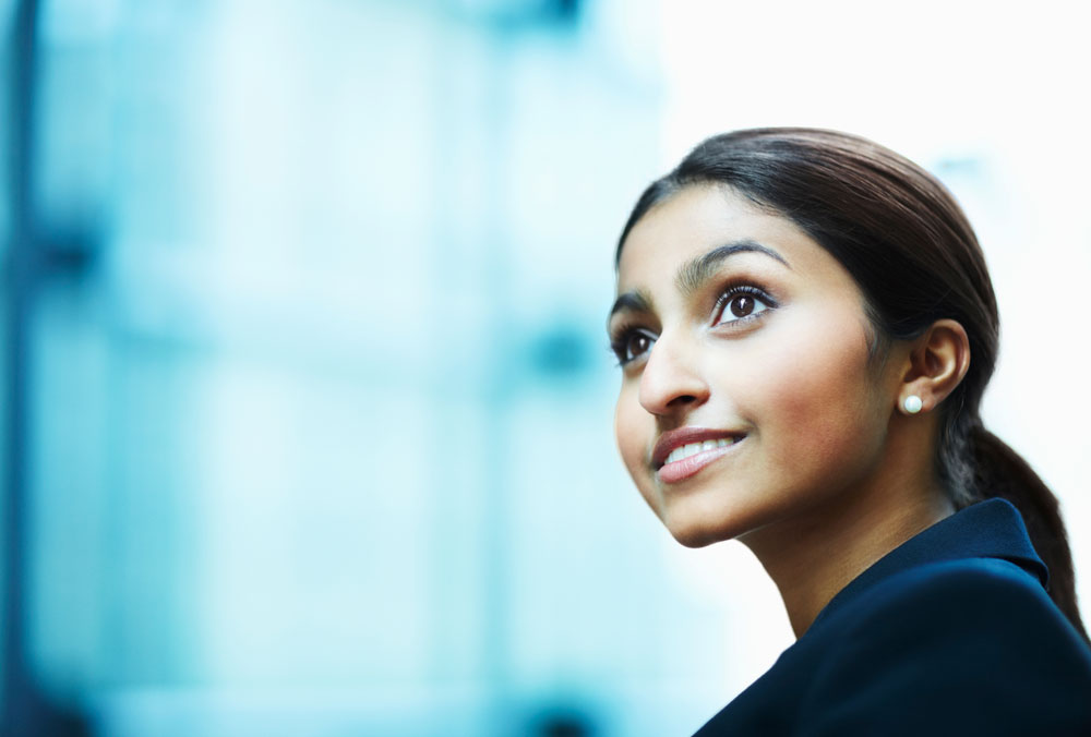 Woman looking away and smiling. © GlobalStock via iStock.