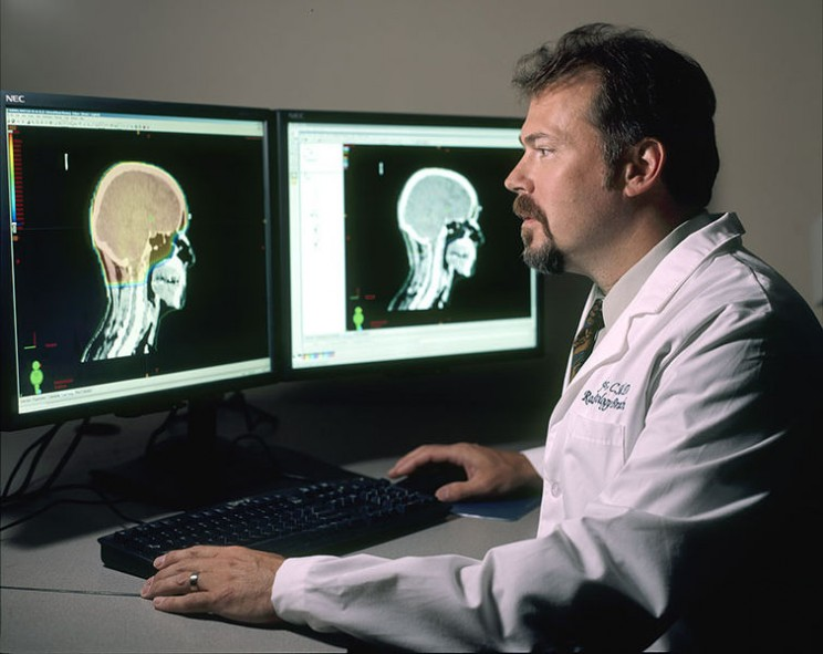 Doctor review brain images by Rhoda Baer. Public domain via  Wikimedia Commons