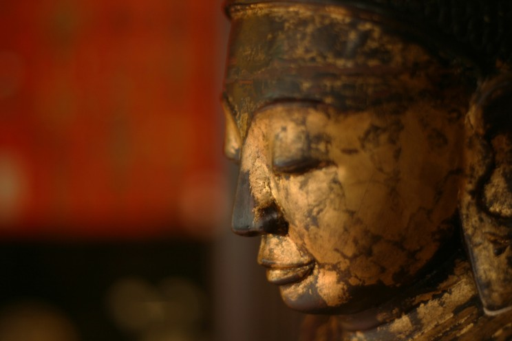 Antique wooden Buddha. Photo by Brian Jeffery Beggerly. CC BY 2.0 via beggs Flickr.