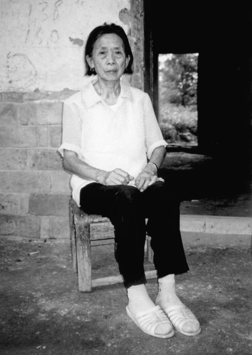 Tan Yuhua, in 2008, in front of her home. Images reproduced with permission of the Publisher from Chinese Comfort Women by Peipei Qiu with Su Zhiliang and Chen Lifei © University of British Columbia Press 2013.