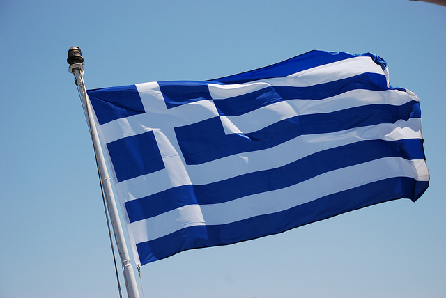 Greek flag. Photo by Trine Juel. CC BY 2.0 via Flickr.