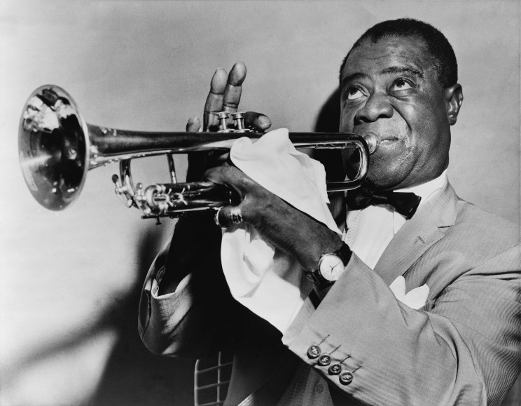 Louis Armstrong, jazz trumpeter. 1953. Library of Congress Prints and Photographs Division, New York World-Telegram and the Sun Newspaper Photograph Collection. Via Wikimedia Commons.