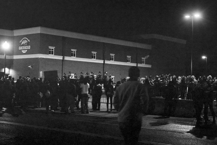 Protests in front of the Ferguson Police Department (and fire station and municipal court), over the Thanksgiving weekend. Photo by Mike Tigas. CC0 1.0 via madmannova Flickr.