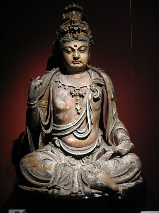 A seated wooden Bodhisattva statue, Jin dynasty (1115–1234), Mountain at Shanghai Museum. CC BY-SA 3.0 via Wikimedia Commons.