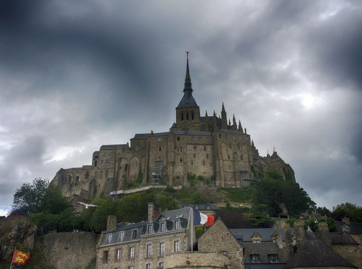 Stormy Sky Above Mont Saint-Michel. Photo by A Guy Taking Pictures. CC BY  2.0 via Flickr