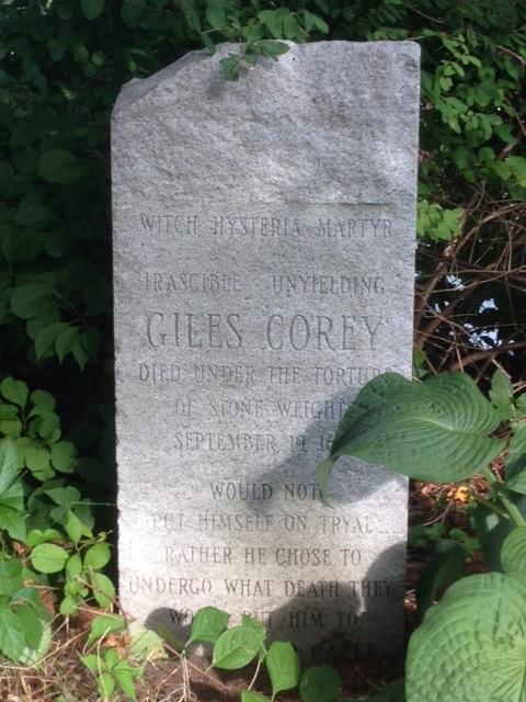 This modern memorial stone stands next to one to Martha Cory, on property they once owned in what is now Peabody, Massachusetts. The actual burial site of the Corys is unknown. Photo by Emerson W. Baker