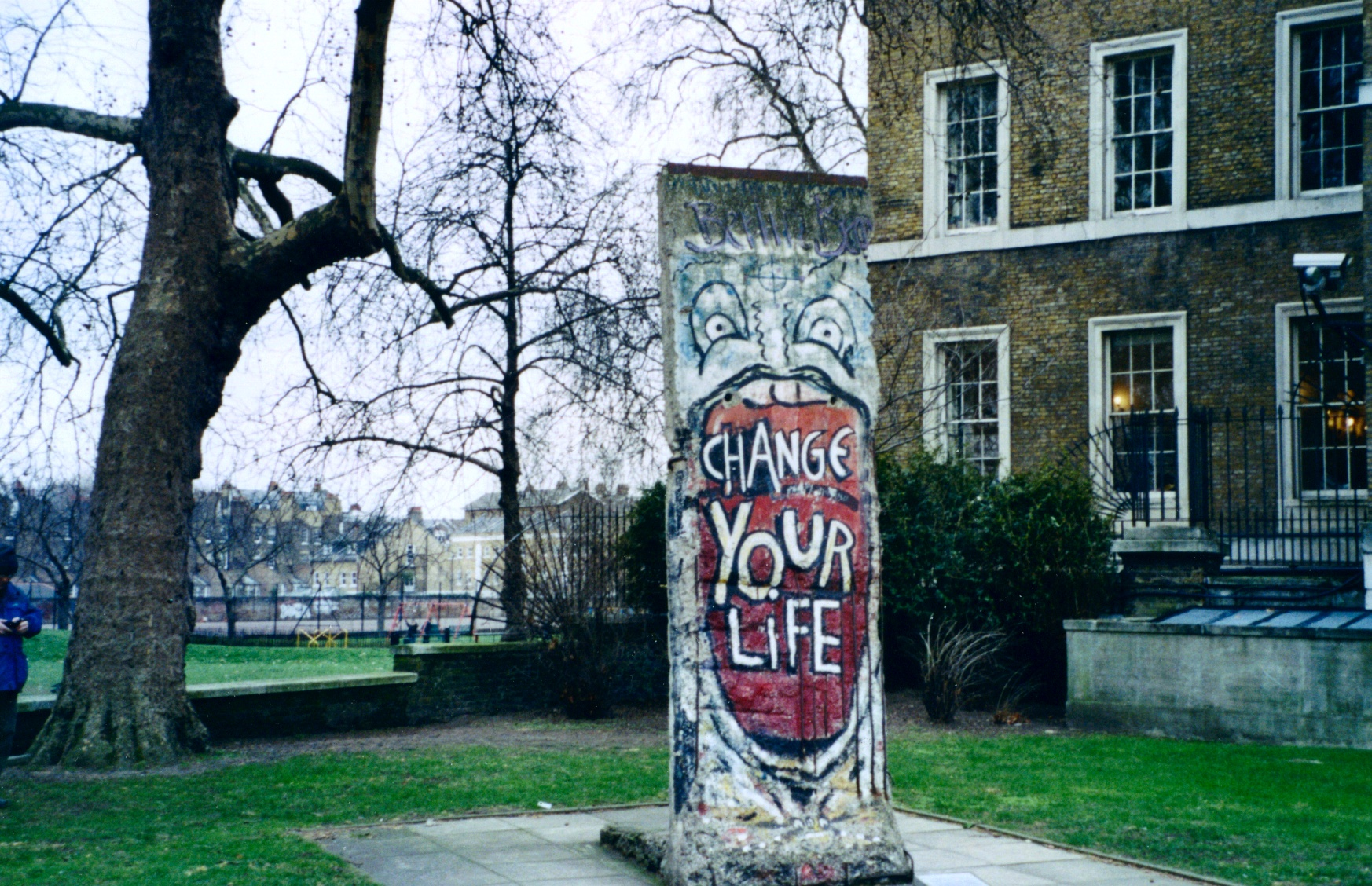 A fragment of the Berlin wall, at the Imperial War Museum, London. Photo by Redvers. Public domain via Wikimedia Commons.