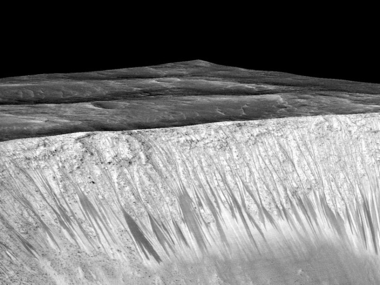 Dark, Recurring Streaks on Walls of Garni Crater by NASA/JPL-Caltech/Univ. of Arizona. Public domain via NASA.