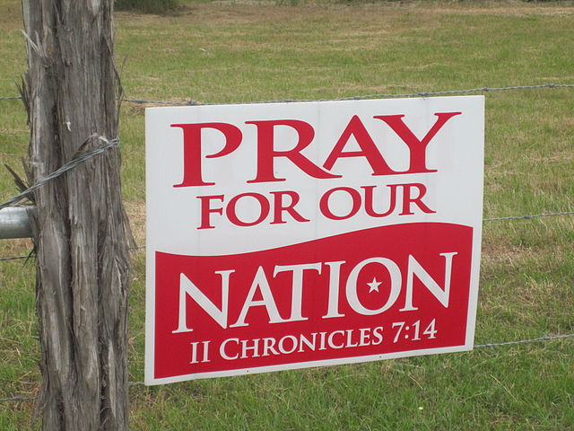 """Photo credit: """"Pray for our nation sign"""" by Billy Hathorn. Public domain via Wikimedia Commons."""