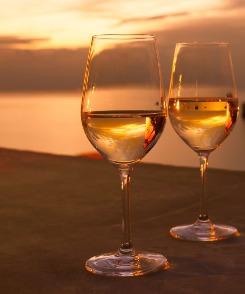 Wine Glasses at Sunset, by kieferpix, © iStock Photo.