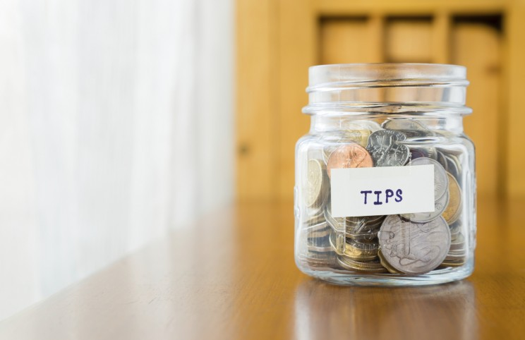 Mind our tip: the word tip has nothing to do with insuring promptness. Anyway, tip it is now called gratuity or even more euphemistically service.