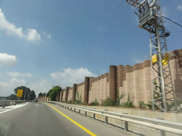 Noise barriers along a highway near Sharon, Israel, by Mattes. Public Domain via Wikimedia Commons.