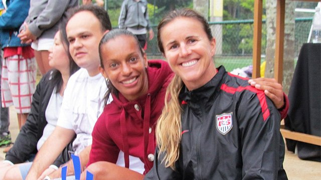 Brandi Chastain poses with Rosana dos Santos Augusto, May 2013 by Bureau of Educational and Cultural Affairs (ECA) of the U.S. Department of State. Public Domain via Wikimedia Commons.