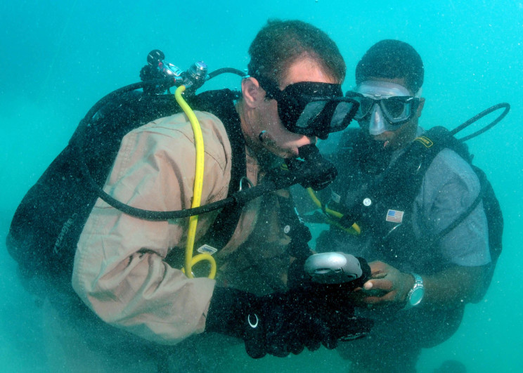 080710-N-8968M-124 ST JOHN'S, Antigua (July 10, 2008) Construction Mechanic 2nd Class Aaron Heldreth checks bottle pressures with his buddy diver, Constable Gaveline Brouet, a Region Security Service diver from St. Lucia, during Navy Diver-Global Fleet Station 2008. The mission of Global Fleet Station is to maintain strong multi-lateral partnerships support the U.S. maritime strategic goals of enhancing regional stability and security by promoting multinational working relationships. U.S. Navy photo by Mass Communication Specialist 2nd Class Kori L. Melvin (Released)