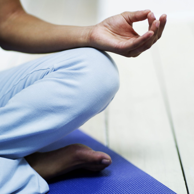 Person Meditating by