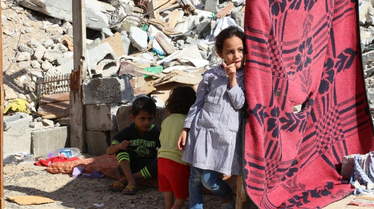 Children sheltering among the rubble of the Gaza strip, 2016. Beller argues that while