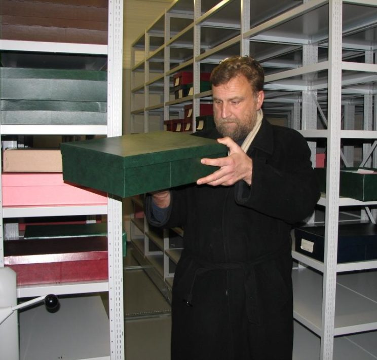 Professor Rimantas Jankauskas helps in the search for Napoleon's buttons in the storage facility of the Lithuanian National Museum in Vilnius. Photo © Lars Öhrström.