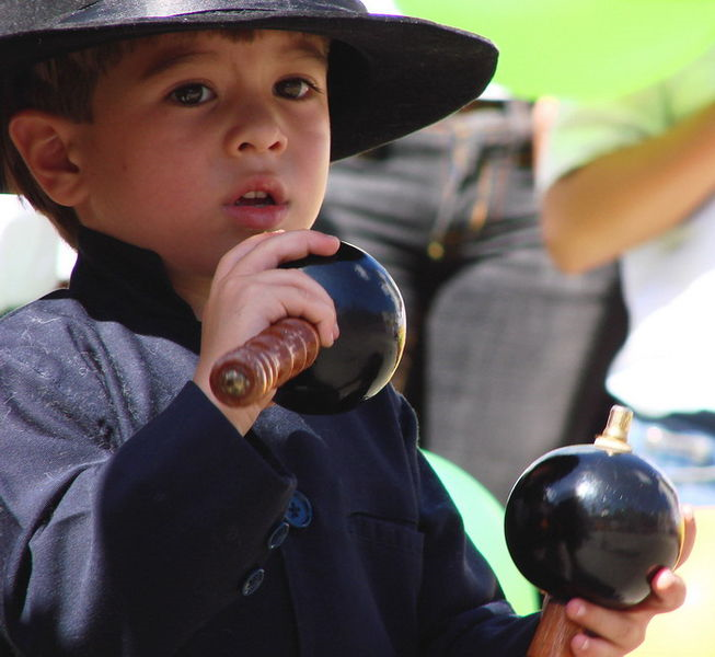 Maraquero: A boy playing maracas at the 2007 Universal Forum of Cultures. Photo by ruumo. CC by Share Alike 2.0 Generic via Wikimedia Commons.