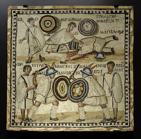 Gladiatorial mosaic from Mérida, Spain. Death of Maternus, killed by Symmachus. 3rd century CE. Photo by Ángel M. Felicísimo, CC BY-SA 2.0 via Wikimedia Commons.
