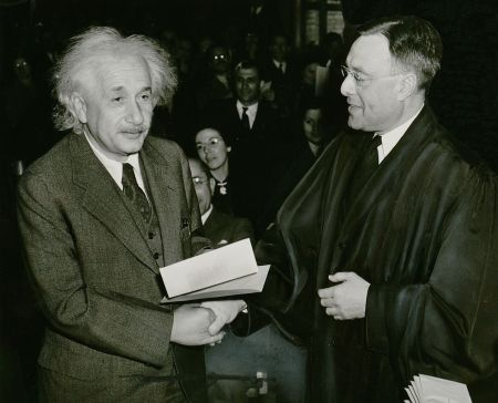 Albert Einstein receives his certificate of American citizenship from Judge Phillip Forman, 1 October 1940. Photo by New York World-Telegram and the Sun staff photographer: Al Aumuller. Public domain via Wikimedia Commons.