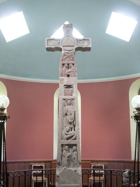 This is the famous Ruthwell Cross erected in England some twelve centuries ago. The word curse has nothing to do with cross