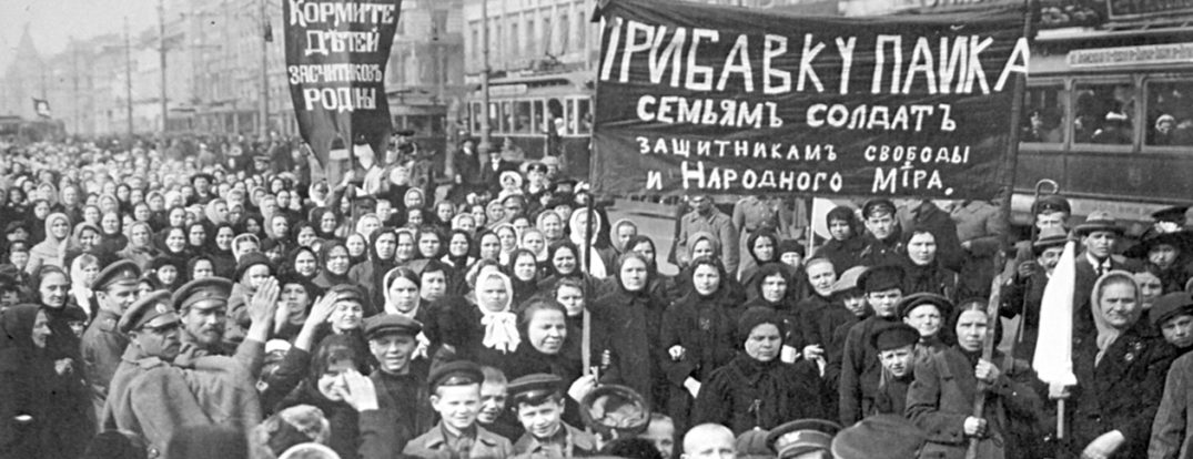 A demonstration of workers from the Putilov plant in Petrograd (modern day St. Peterburg), Russia, during the February Revolution. Public domain via Wikimedia Commons.