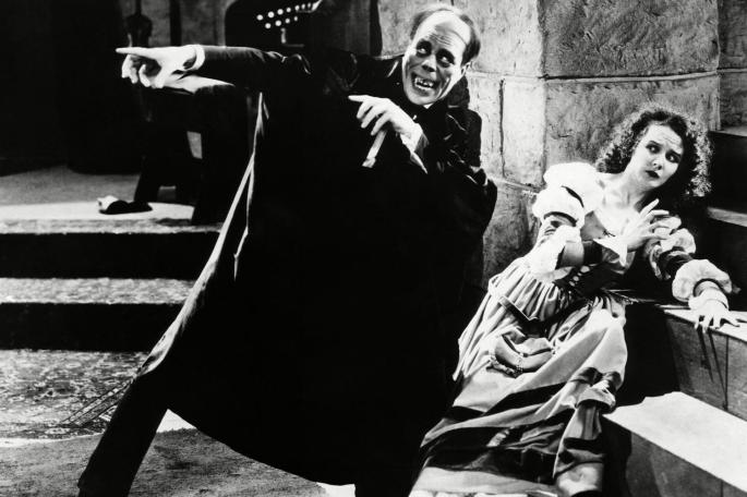 """Lon Chaney and Mary Philbin in the 1925 silent movie The Phantom of the Opera— although the """"grisly mask"""" he wore limited his facial expressiveness, """"Chaney's best acting, with his hands, is to be seen in this picture,"""" according to reviewer Carl Sandburg. Public Domain via Wikimedia Commons."""