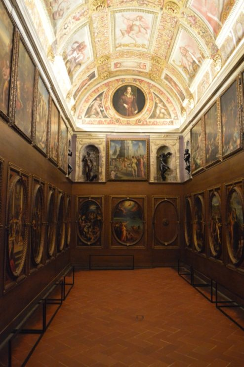 Image of Francesco I de' Medici's private studiolo in 2018, displaying Renaissance oil paintings for museum visitors
